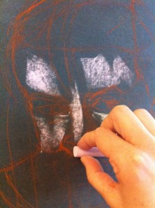 applying the first pastel strokes to the portrait painting
